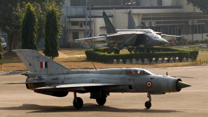 Mig-21 FL taxying past a phased out Mig-25 trainer aircraft at Kalikunda airbase in West Bengal. The Mig-21 FL will also be phased out of IAF on Dec 11, 2013 after completing 50 years of service.